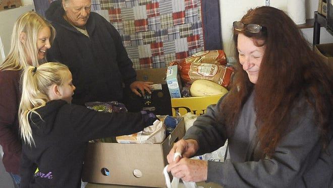 Volunteers pack bags of food at the Yerington Food Pantry.