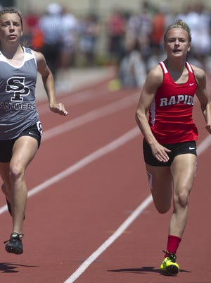 Wisconsin Rapids' Grace Hartman, right, has been one of the top girls sprinters in the state so far this spring.