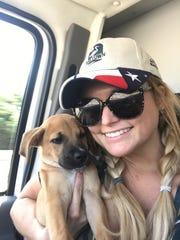 Miranda Lambert cuddles a puppy MuttNation Foundation pulled from a Houston-area shelter.