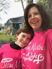 """Jamie Bass, right, and her son Luke show off their """"Team Martha"""" T-shirts, made to support Jamie's mother, Martha Bass, during her fight against breast cancer."""