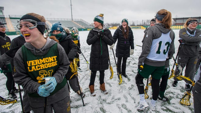University of Vermont women's lacrosse coach Sarah Dalton, center, shares a laugh with her team at practice in Burlington on Tuesday, February 1, 2017.