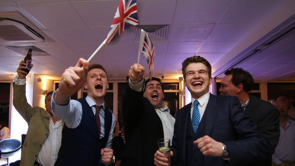 Leave.EU supporters wave Union flags and cheer as the