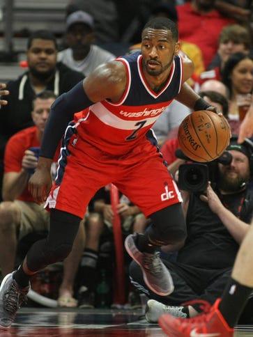 Washington Wizards guard John Wall (2) continues his