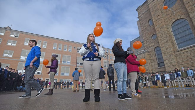 St. Peter's High School students held a vigil Wednesday morning to remember the 17 victims of the school shooting at Marjory Stoneman Douglas High School in Parkland, Florida. The students prayed, observed moments of silence and released 1 balloon for each victim killed.