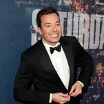 """In this Feb. 15, 2015 file photo, Jimmy Fallon attends the SNL 40th Anniversary Special in New York. Fallon donned a period costume Monday, May 16, 2016, for a """"Hamilton"""" takeoff at NBC's annual presentation of next season's schedule. The """"Tonight"""" show host walked down the aisle at Radio City Music Hall for a comic spoof on the business of television."""