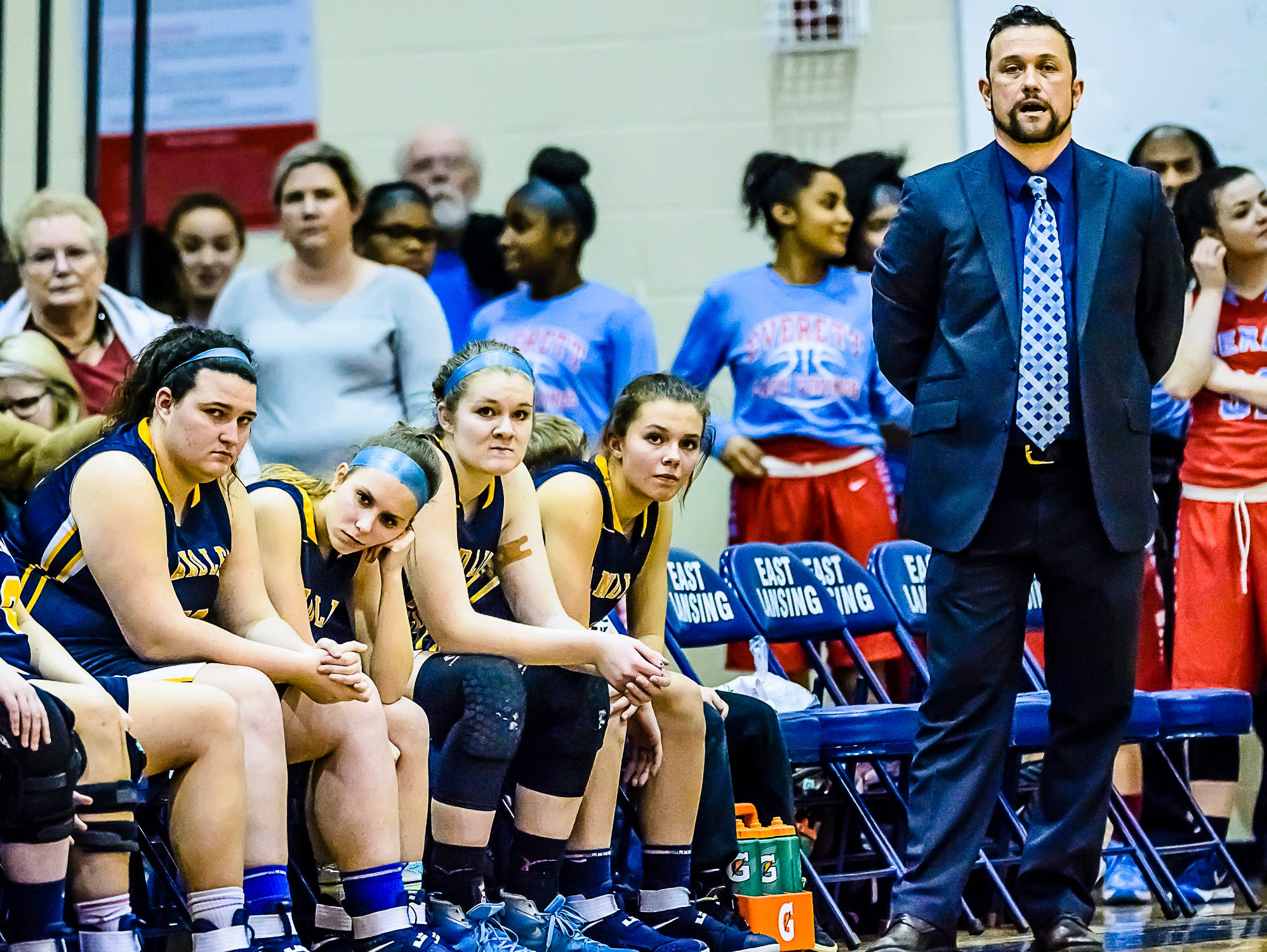 The Grand Ledge bench looks on in the last seconds of their district semifinal loss to East Lansing Wednesday March 1, 2017 at East Lansing High School. KEVIN W. FOWLER PHOTO