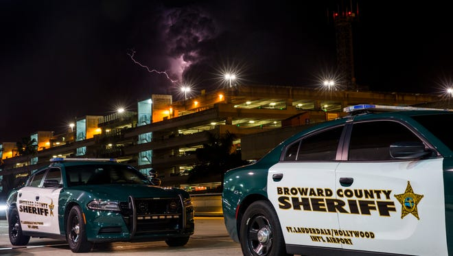Broward County sheriff's vehicles park outside Terminal 2 at the Fort Lauderdale-Hollywood International Airport in Fort Lauderdale, Fla. on Saturday, Jan. 7, 2017.