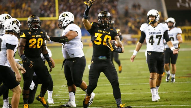ASU defensive back Dasmond Tautalatasi (30) celebrates blocking a punt then recovering the ball against Colorado at Sun Devil Stadium on Oct. 10, 2015 in Tempe.