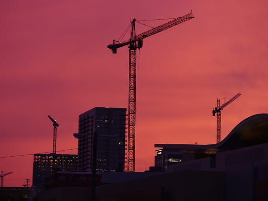 Construction cranes in downtown Nashville skyline during