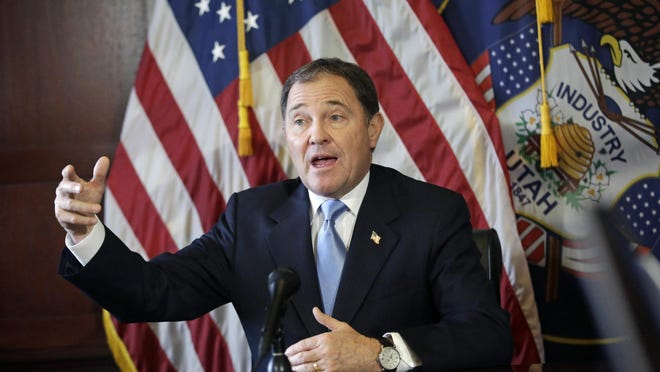 In this Thursday, Feb. 5, 2015 file photo, Utah Gov. Gary Herbert speaks during a news conference at the Utah State Capitol, in Salt Lake City. Planned Parenthood of Utah sued the governor on Monday, Sept. 28, for ordering state agencies to cut off federal funding to the organization following the release of secretly recorded videos by an anti-abortion group.
