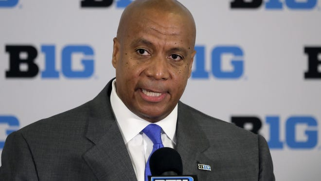 FILE - In this June 4, 2019, file photo, Kevin Warren talks to reporters after being named Big Ten Conference Commissioner during a news conference in Rosemont, Ill. Leaders of six state legislatures in the Big Ten footprint have sent a letter to commissioner Kevin Warren asking the conference to reconsider its decision to cancel the  fall football season. The letter is written on the letterhead of Michigan House speaker Lee Chatfield and also signed by statehouse leaders from Iowa, Minnesota, Ohio, Wisconsin and Pennsylvania.