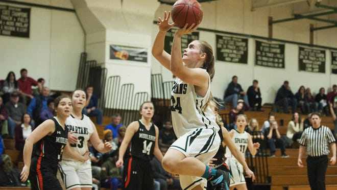 Winooski's Mariah Metivier (34) leaps for a aly up during the girls basketball game between Middlebury and Winooski on Saturday afternoon.