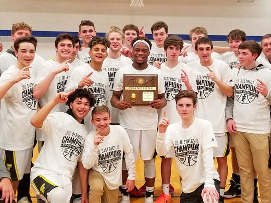 Tanis (front row) energized the team which won the District Championship for only the third time in Fairview High mens basketball history.