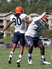 UTEP defensive lineman Denzel Chukwukelu, 11, celebrates with teammate Keith Sullivan, 90, after stopping a play Friday at Camp Ruidoso.