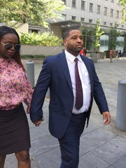 Former University of Arizona assistant men's basketball coach Emanuel Richardson leaves Manhattan federal court in New York on Oct. 10, 2017.