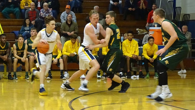 Lancaster's Jacob England drives to the basket as Rocky Jorgenson sets a pick during the Golden Gales' 68-40 win over Hamilton Township Tuesday night.