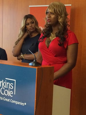 Actress Laverne Cox (left) joins Monica Jones to appeal Jones' conviction of a controversial prostitution-related offense on Aug. 5, 2014, in Phoenix.