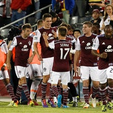 May 24, 2014; Commerce City, CO, USA; Colorado Rapids midfielder Dillon Serna (17) congratulates defender Shane O'Neill (27) after his goal in the second half against the Montreal Impact at Dick's Sporting Goods Park. The Rapids defeated the Impact 4-1. Mandatory Credit: Isaiah J. Downing-USA TODAY Sports