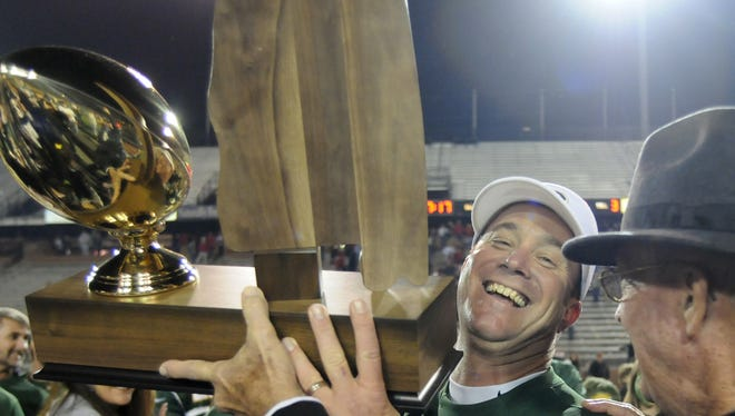 Edgewood head coach Bobby Carr is presented with the trophy after their 41-0 win over Springwood in the AISA Class AA State Championship on Friday, Nov. 19, 2010, at Troy University. (Montgomery Advertiser, Amanda Sowards)