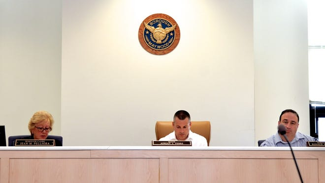 "20025096A(Presto ID 94074856) 11/19/2016 Maywood, NJ. Maywood Special Council meeting to make the ""Sustainability Pledge"". Left to right: Borough Clerk Jean M. Pelligra, Mayor Adrian J. Febre, Borough Attorney Ronald A. Dario participate. Carl Su/Staff photographer"