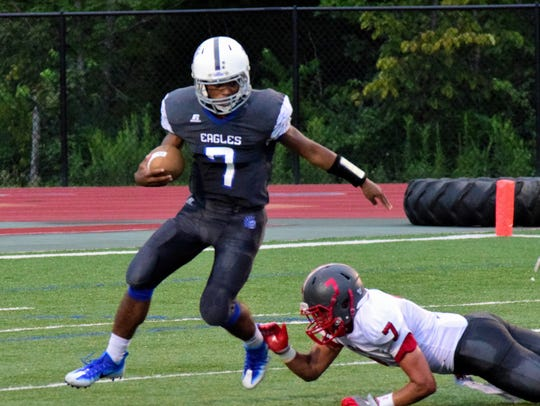 Scott quarterback Nelson Perrin (7) slips by Dixie