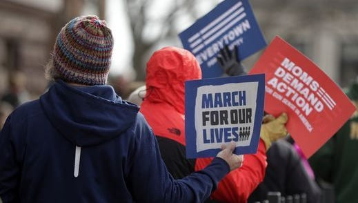Protesters participate in Green Bay's March for Our Lives, a nationwide event held March 24, 2018, to voice concerns about gun violence following a mass shooting at Marjory Stoneman Douglas High School in Parkland, Florida, where 19-year-old Nikolas Cruz is accused of killing 17 people.