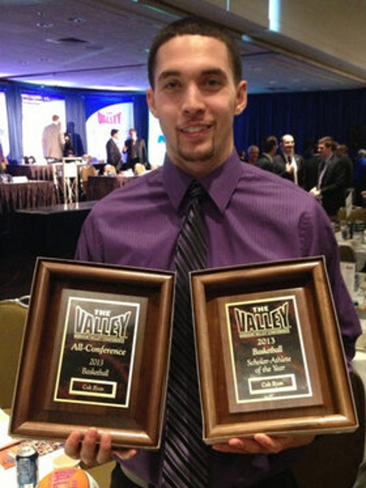 """Per """"Voice of the Aces"""" Lance Wilkerson, UE senior Colt Ryan with his hardware."""