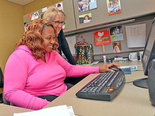 Methodist Rehabilitation Center speech therapist Kathleene Shapley, right, shares a light moment with Coretta Greathouse as she does activities to improve her thinking and language skills.