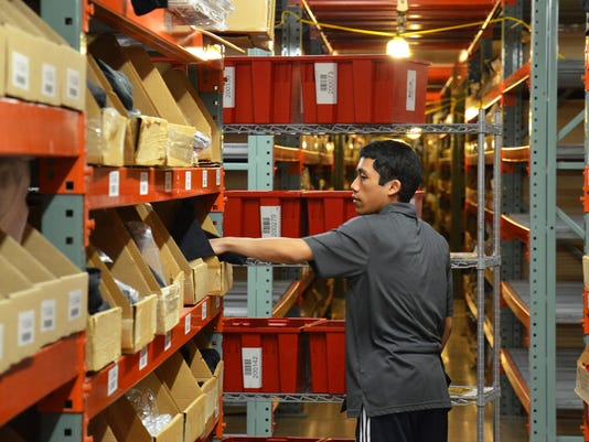 An employee picks packages at Radial's fulfillment center in Reno.