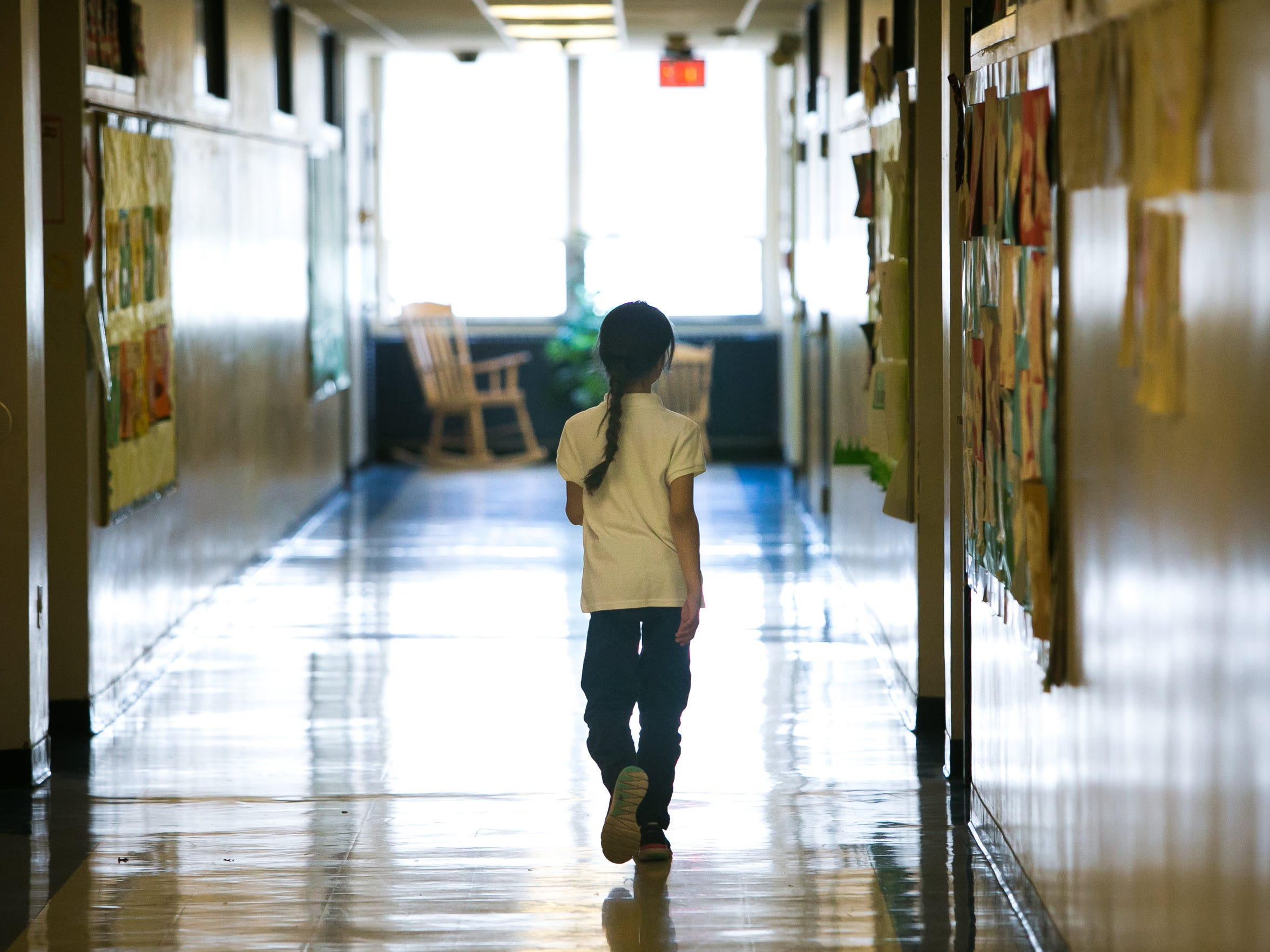 A student walks down the hallway of Casimir Pulaski Elementary School in Wilmington. Across the board, Delaware students performed slightly better in the second year of a more difficult state test.