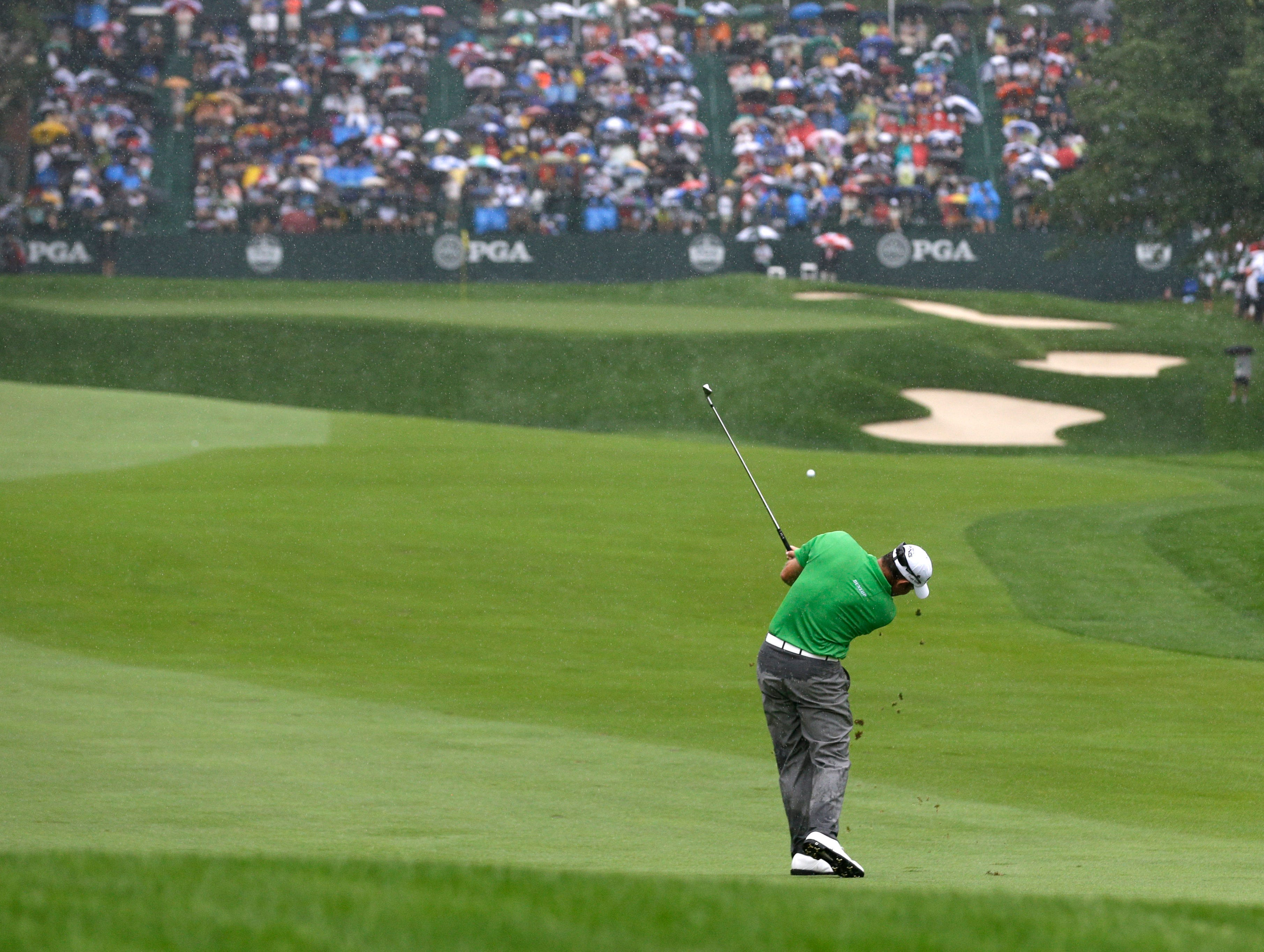 Lee Westwood hits from the fairway on the 18th hole.