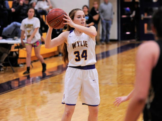 Wylie's Julia Lovelace (34) makes a pass during the 72-42 win against Big Spring on Friday, Jan. 26, 2018. Lovelace scored 11 points in the win.