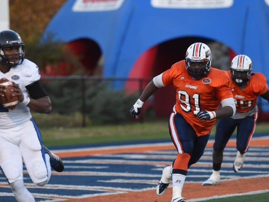 UTM's Damani Taylor, a Westview grad, pursues Eastern Ilinois quarterback Jalen Whitlow on Saturday.