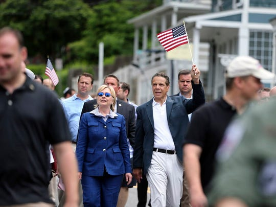 New York Gov. Andrew Cuomo waves a American flag as