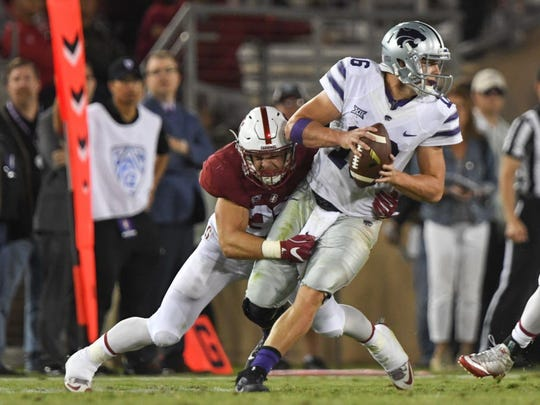 Stanford linebacker Joey Alfieri sacks Kansas State quarterback Jesse Ertz (16) during the fourth quarter.