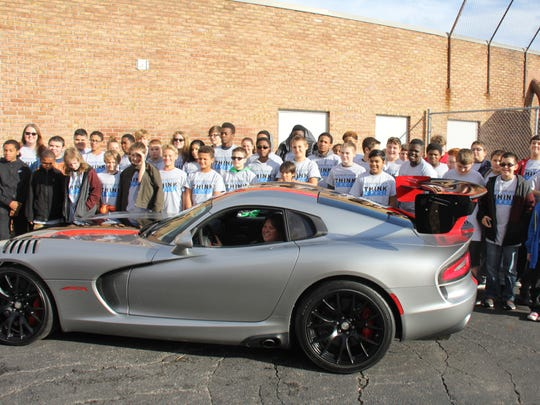 Teacher Kim Mandrelle in the Dodge Viper with Stevenson