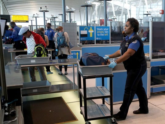 A Transportation Security Administration officer handles