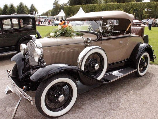 A 1930 Ford Model A roadster is among the vehicles