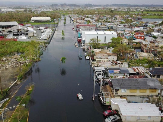 An aerial view shows the flooded neighborhood of Juana