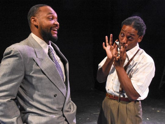 "Rapheal Hamilton (left) and Calvin J. Worthen in Black Theatre Troupe's production of ""Seven Guitars."""