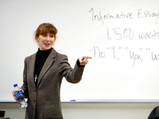 In this photo taken Oct. 11, 2017, Ellen Tara James-Penney, a lecturer at San Jose State University, speaks to her English class on the university's campus in San Jose, Calif. The booming economy along the West Coast has led to an historic shortage of affordable housing and has upended the stereotypical view of people out on the streets. Reporting by The Associated Press finds that many of them are employed, working as retail clerks, plumbers, janitors _ even teachers. They go to work, sleep where they can and buy gym memberships for a place to shower. (AP Photo/Marcio Jose Sanchez)