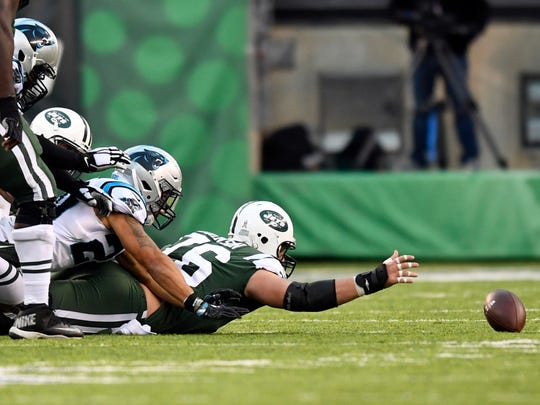 New York Jets center Wesley Johnson (76) cannot grab the ball after New York Jets quarterback Josh McCown (not pictured) fumbled for a turnover in the second half. The Carolina Panthers defeat the New York Jets 35-27 on November 26, 2017 in East Rutherford, NJ.