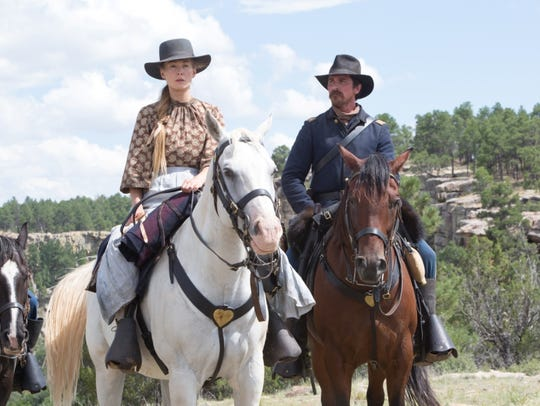 "Rosamund Pike and Christian Bale in ""Hostiles."""