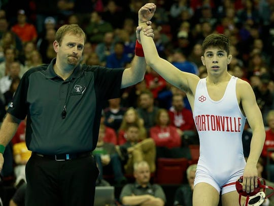 Hortonville's Eric Barnett, top, defeats Hartland Arrowhead's Jack Ganos during their 113-pound Division 1 championship match at the WIAA individual state wrestling tournament Saturday at the Kohl Center in Madison.