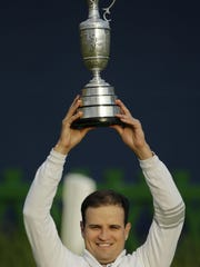 David J. Phillip/APZach Johnson poses with the trophy after winning a playoff after the final round of the British Open on Monday at St. Andrews, Scotland. Zach Johnson poses with the trophy after winning a playoff after the final round of the British Open on Monday at the Old Course at St. Andrews, Scotland. David J. Phillip/AP