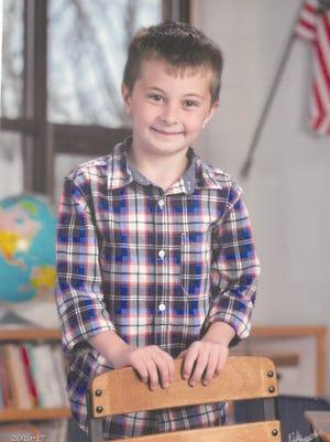John Harvilicz Jr., 8, 'liked everything superhero,' according to his obituary.