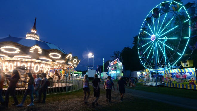 Amusement rides light up the night Aug. 20, 2019, at the Crawford County Fair in West Mead Township. The 2020 fair has been canceled because of COVID-19 concerns.