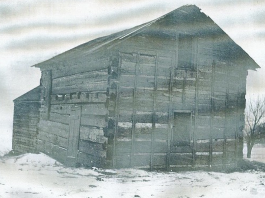 On cold and lonely winter days, a Swiss family named Wurster found warmth and companionship in the log house they built near 51st Street and Howard Avenue. Although made of logs, the two-story home is not a log cabin. It's logs have been shaved flat. The house is gone, now.