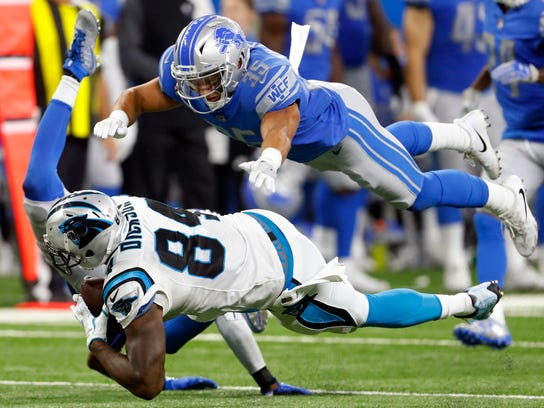 Carolina Panthers tight end Ed Dickson (84) is upended by Detroit Lions strong safety Tavon Wilson as strong safety Miles Killebrew (35) closes in during the second half of an NFL football game, Sunday, Oct. 8, 2017, in Detroit. (AP Photo/Paul Sancya)