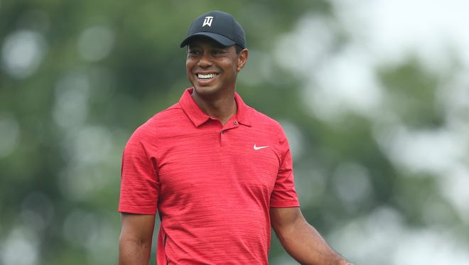 Tiger Woods smiles during the final round of The Memorial golf tournament at Muirfield Village Golf Club.